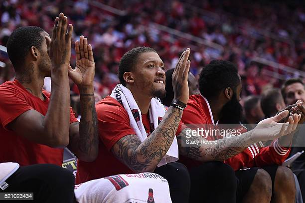 Michael Beasley of the Houston Rockets cheers from the bench during the second half of a game against the Sacramento Kings at the Toyota Center on...