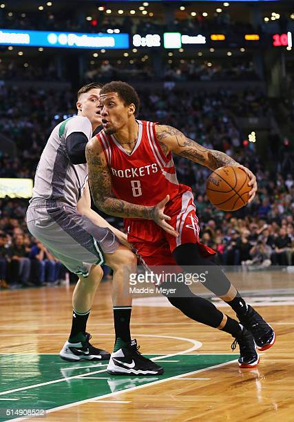 Michael Beasley of the Houston Rockets drives against Jonas Jerebko of the Boston Celtics during the first quarter at TD Garden on March 11 2016 in...