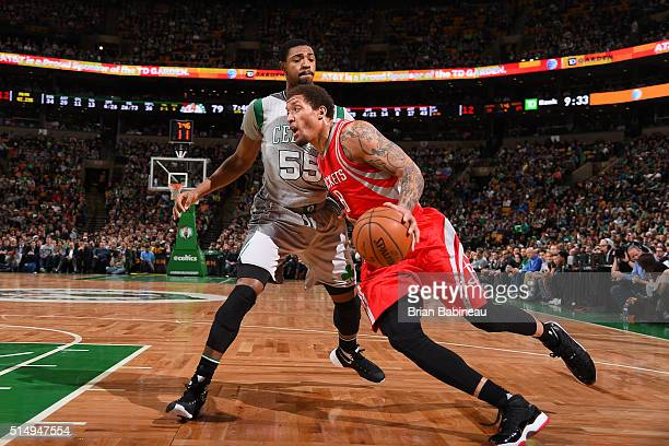 Michael Beasley of the Houston Rockets handles the ball against Jordan Mickey of the Boston Celtics on March 11 2016 at the TD Garden in Boston...