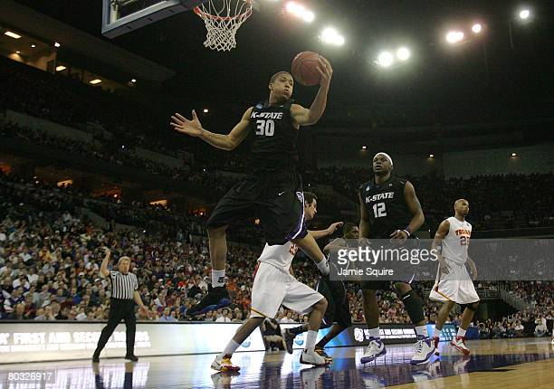 Michael Beasley of the Kansas State Wildcats grabs a rebound against the USC Trojans during the Midwest Region first round of the 2008 NCAA Men's...
