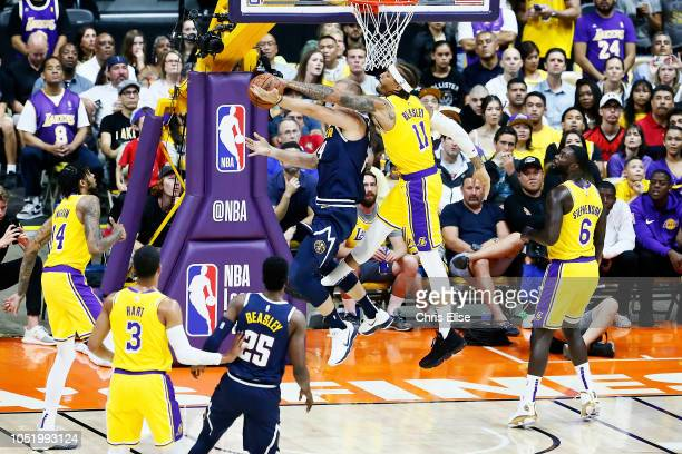 Michael Beasley of the Los Angeles Lakers blocks the shot on Mason Plumlee of the Denver Nuggets during the game on September 30 2018 at Valley View...