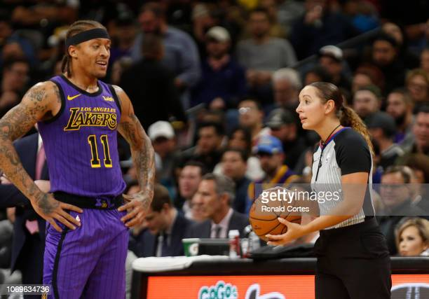 Michael Beasley of the Los Angeles Lakers eyes official Ashley MoyerGleich after she called a foul on him during game against the San Antonio Spurs...