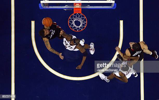 Michael Beasley of the Miami Heat attempts the slam on Mario Chalmers of New Jersey Nets during the NBA preseason game as part of the 2008 NBA Europe...