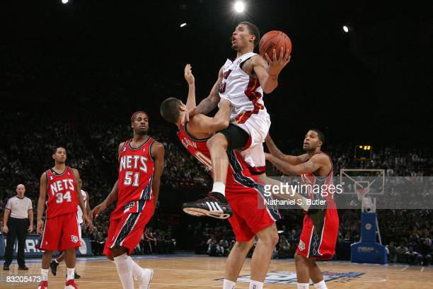 Michael Beasley of the Miami Heat drives into Ryan Anderson during the preseson game part of the 2008 NBA Europe Live Tour on October 9 2008 at the...