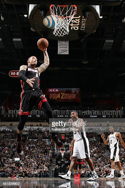 Michael Beasley of the Miami Heat dunks against the San Antonio Spurs during Game Five of the 2014 NBA Finals at ATT Center on June 15 2014 in San...