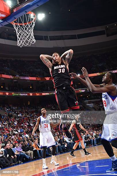 Michael Beasley of the Miami Heat dunks the ball against the Philadelphia 76ers at Wells Fargo Center on April 15 2015 in Philadelphia Pennsylvania...