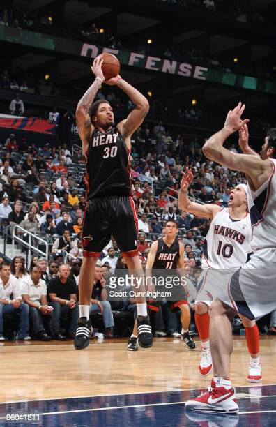 Michael Beasley of the Miami Heat puts up a shot against the Atlanta Hawks in Game One of the Eastern Conference Quarterfinals during the NBA...