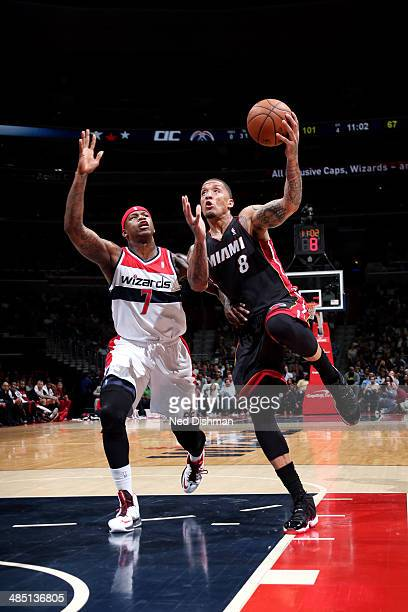 Michael Beasley of the Miami Heat shoots against Al Harrington of the Washington Wizards at the Verizon Center on April 14 2014 in Washington DC NOTE...