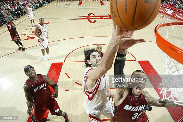 Michael Beasley of the Miami Heat shoots the ball over Luis Scola of the Houston Rockets on January 15 2010 at the Toyota Center in Houston Texas...