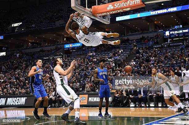 Michael Beasley of the Milwaukee Bucks dunks against the Orlando Magic during the first half of a game at BMO Harris Bradley Center on November 21...