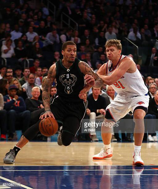 Michael Beasley of the Milwaukee Bucks in action against Mindaugas Kuzminskas of the New York Knicks during their game at Madison Square Garden on...