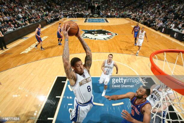 Michael Beasley of the Minnesota Timberwolves pulls down a rebound against Jared Jeffries of the New York Knicks during the game on February 11 2012...