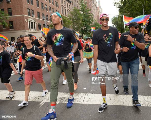 Michael Beasley of the New York Knicks and John Henson of the Milwaukee Bucks during the NYC Pride Parade on June 24 2018 in New York City New York...