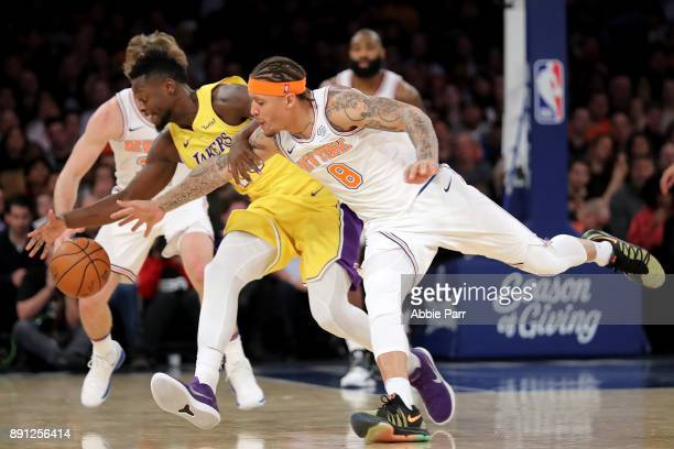 Michael Beasley of the New York Knicks and Julius Randle of the Los Angeles Lakers reach for the ball in the third quarter during their game at...