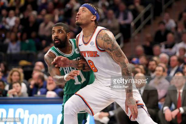 Michael Beasley of the New York Knicks and Kyrie Irving of the Boston Celtics fight for the ball in the fourth quarter during their game at Madison...