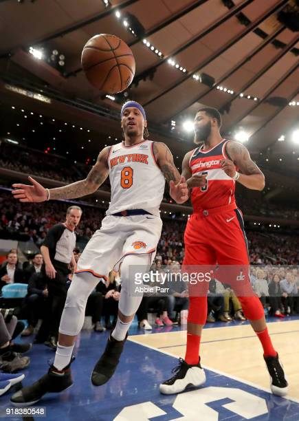 Michael Beasley of the New York Knicks and Markieff Morris of the Washington Wizards go for the ball in the second quarter during their game at...