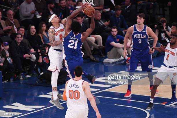 Michael Beasley of the New York Knicks blocks a shot made by Joel Embiid of the Philadelphia 76ers during the game at Madison Square Garden on March...