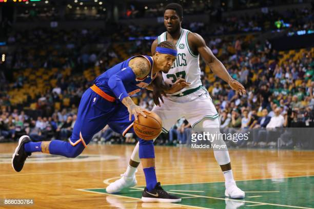 Michael Beasley of the New York Knicks drives against Semi Ojeleye of the Boston Celtics during the fourth quarter at TD Garden on October 24 2017 in...