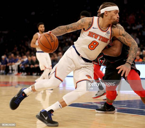 Michael Beasley of the New York Knicks drives past David Nwaba of the Chicago Bulls at Madison Square Garden on January 10 2018 in New York CityThe...
