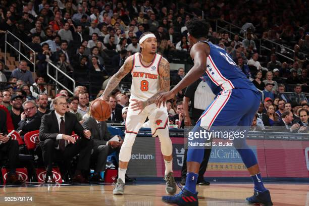 Michael Beasley of the New York Knicks handles the ball against Joel Embiid of the Philadelphia 76ers during the game between the two teams on March...