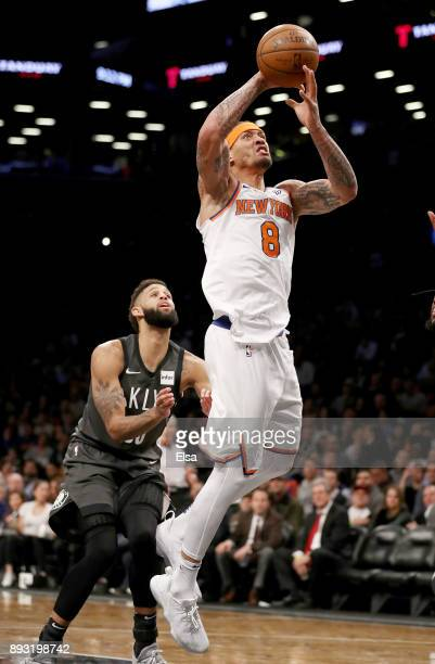 Michael Beasley of the New York Knicks heads for the net as Allen Crabbe of the Brooklyn Nets defends at the Barclays Center on December 14 2017 in...