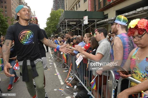 Michael Beasley of the New York Knicks high fives crowds during the NYC Pride Parade on June 24 2018 in New York City New York NOTE TO USER User...