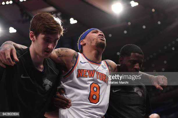 Michael Beasley of the New York Knicks is carried out of the court after getting injured during the game against the Miami Heat at Madison Square...