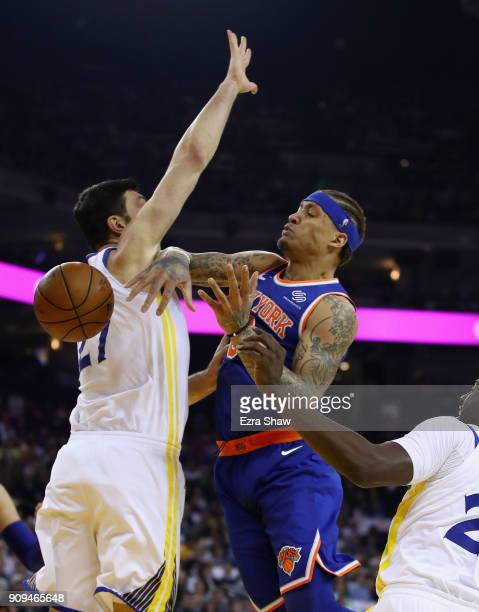 Michael Beasley of the New York Knicks looses control of the ball while going up for a shot against Zaza Pachulia of the Golden State Warriors at...