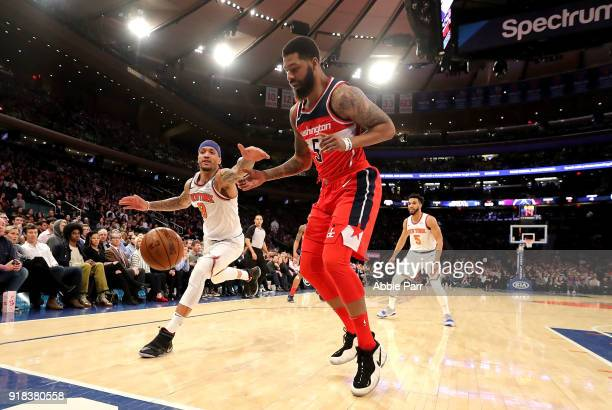 Michael Beasley of the New York Knicks reaches for the ball against Markieff Morris of the Washington Wizards in the second quarter during their game...