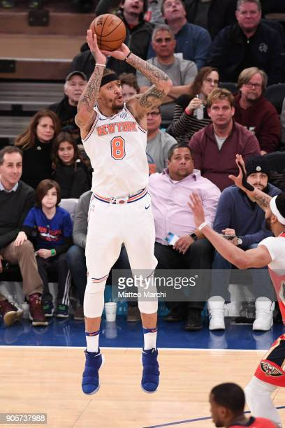 Michael Beasley of the New York Knicks shoots the ball against Anthony Davis of the New Orleans Pelicans during the first half of the game at Madison...