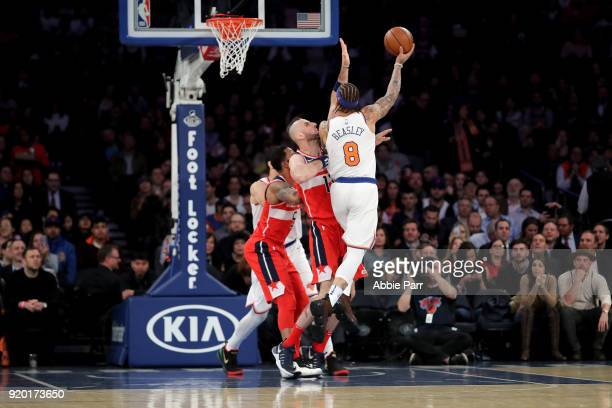 Michael Beasley of the New York Knicks takes a shot against Marcin Gortat of the Washington Wizards in the first half during their game at Madison...