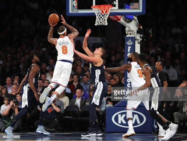 Michael Beasley of the New York Knicks takes a shot against Nikola Jokic of the Denver Nuggets in the second half during their game at Madison Square...