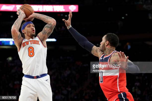 Michael Beasley of the New York Knicks takes shot against Mike Scott of the Washington Wizards in the fourth quarter during their game at Madison...
