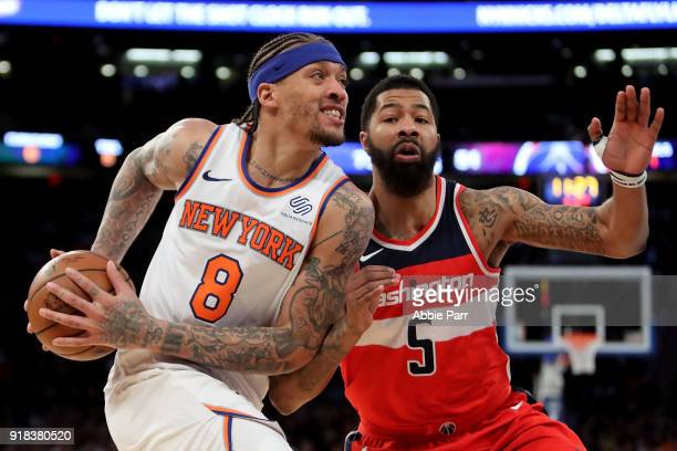 Michael Beasley of the New York Knicks works against Markieff Morris of the Washington Wizards in the third quarter during their game at Madison...
