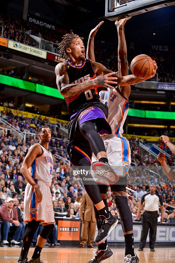 Michael Beasley #0 of the Phoenix Suns drives to the basket against the Oklahoma City Thunder on February 10, 2013 at U.S. Airways Center in Phoenix, Arizona.