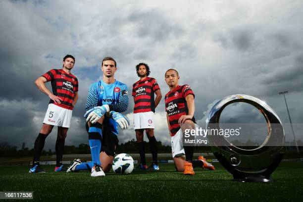 Michael Beauchamp Ante Covic Shinji Ono and Nikolai ToporStanley pose with the ALeague trophy during a Western Sydney Wanderers ALeague training...