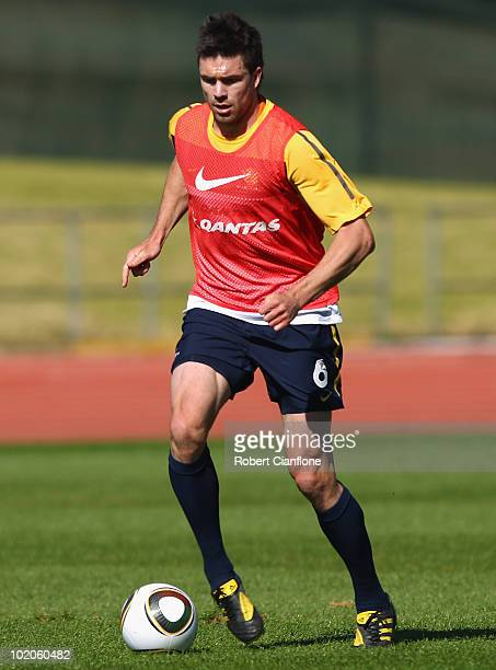 Michael Beauchamp of Australia runs with the ball during an Australian Socceroos training session at Ruimsig Stadium on June 14 2010 in Roodepoort...