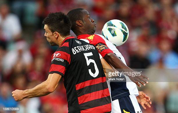 Michael Beauchamp of the Wanderers and Bruce Djite of Adelaide contest possession during the round 12 ALeague match between the Western Sydney...