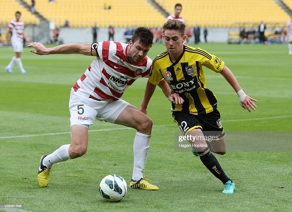 Michael Beauchamp of the Wanderers and Tyler Boyd of the Phoenix compete for the ball during the round 16 A-League match between the Wellington Phoenix and the Western Sydney Wanderers at Westpac Stadium on January 13, 2013 in Wellington, New Zealand.