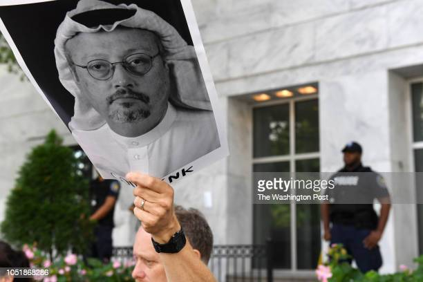 Michael Beer holds a poster during a rally about the disappearance of Washington Post journalist Jamal Khashoggi outside the Embassy of Saudi Arabia...