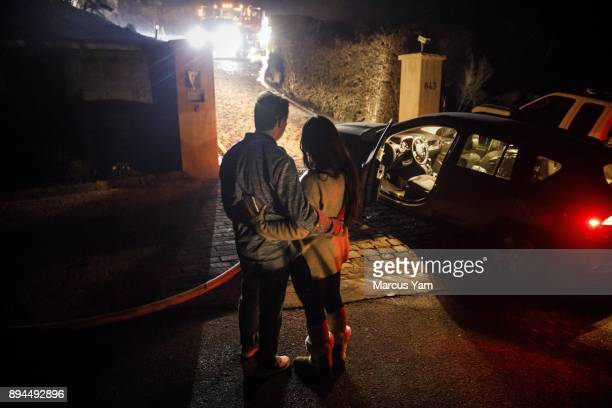 Michael Behrman and his wife Sonia take one last look at their home that was destroyed by the Thomas Fire before packing up and leaving for the night...
