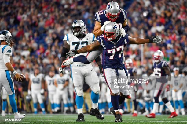 Michael Bennett celebrates with teammate Kyle Van Noy of the New England Patriots after completing a sack in the third quarter during a preseason...