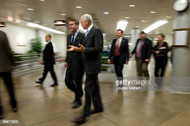 Michael Bennett DCO and Orrin Hatch RUT talk on the way to the first vote of the day during the Saturday work session on the health care bill...