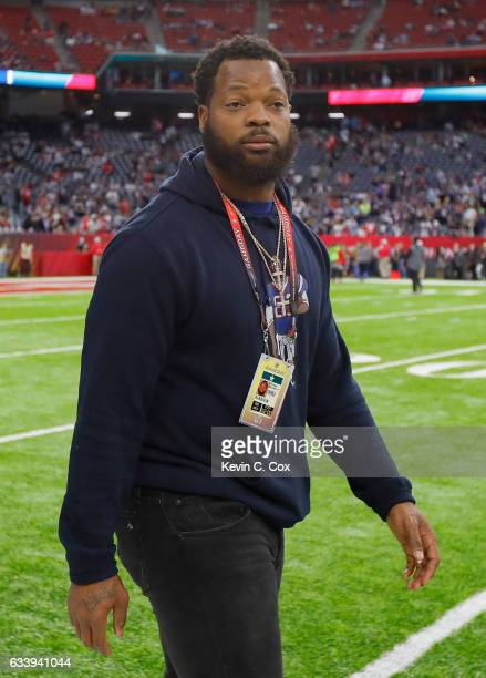 Michael Bennett Jr of the Seattle Seahawks walks on the sideline before Super Bowl 51 between the New England Patriots and the Atlanta Falcons at NRG...