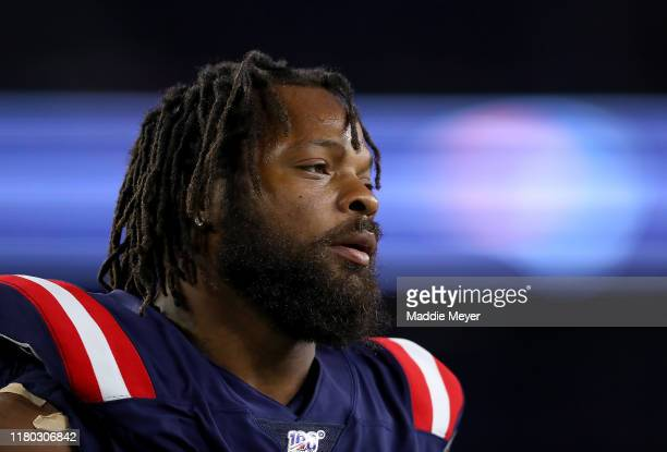 Michael Bennett of the New England Patriots looks on prior to the game against the New York Giants at Gillette Stadium on October 10 2019 in...