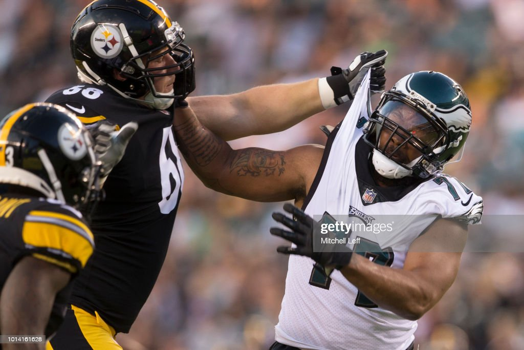 Michael Bennett #77 of the Philadelphia Eagles rushes against Jake Rodgers #68 of the Pittsburgh Steelers in the second quarter during the preseason game at Lincoln Financial Field on August 9, 2018 in Philadelphia, Pennsylvania.