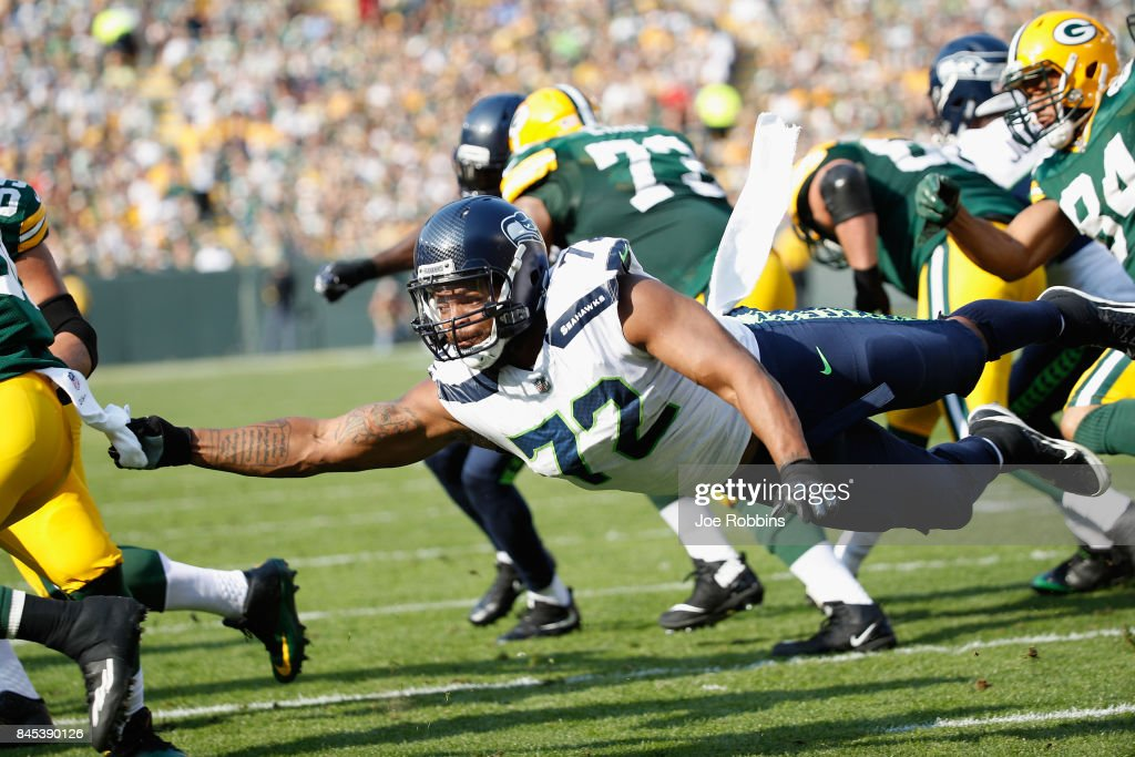 Michael Bennett #72 of the Seattle Seahawks attempts to tackle Ty Montgomery #88 of the Green Bay Packers during the first half at Lambeau Field on September 10, 2017 in Green Bay, Wisconsin.