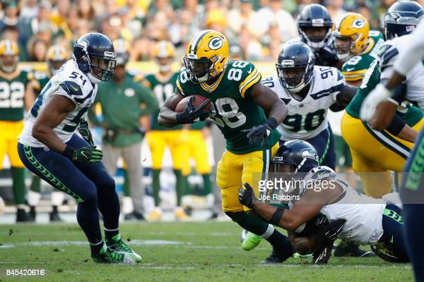 Michael Bennett of the Seattle Seahawks attempts to tackle Ty Montgomery of the Green Bay Packers during the fourth quarter at Lambeau Field on...
