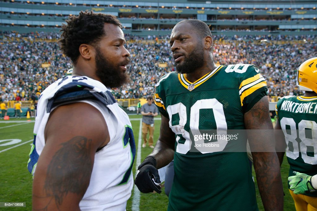 Michael Bennett #72 of the Seattle Seahawks talks with brother Martellus Bennett #80 of the Green Bay Packers after the Packers defeated the Seahawks 17-9 at Lambeau Field on September 10, 2017 in Green Bay, Wisconsin.