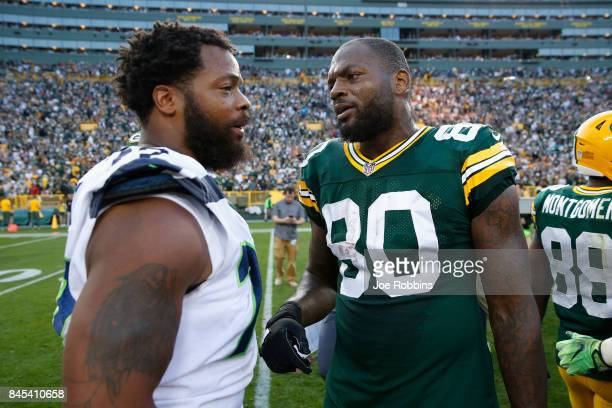 Michael Bennett of the Seattle Seahawks talks with brother Martellus Bennett of the Green Bay Packers after the Packers defeated the Seahawks 179 at...